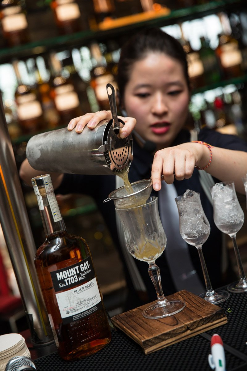 First runner up, Ying Ying, preparing her cocktail named, Sipping Nightfall